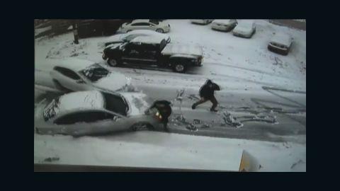pkg car slides in snow hits person_00001302.jpg