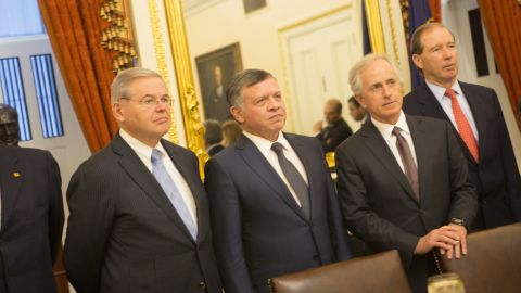 King Abdullah II of Jordan (third left) poses for a photo before meeting with members of the U.S. Foreign Relations Committee, including Sen. Robert Menendez (D-NJ) (second left) and Sen. Bob Corker (R-TN) (second right) February 3, 2015 on Capitol Hill in Washington, D.C.