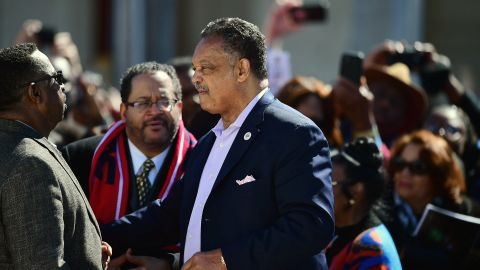 The Rev. Jesse Jackson speaks with people ahead of the event.