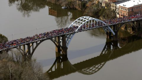 Crowds of people move in a symbolic walk across the bridge on March 8.