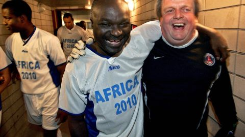 """Former player and official Jean-Michel Moutier, pictured here with Cameroon legend Roger Milla, believes """"the true value of sport is that everyone is there thanks to their talent and work."""""""