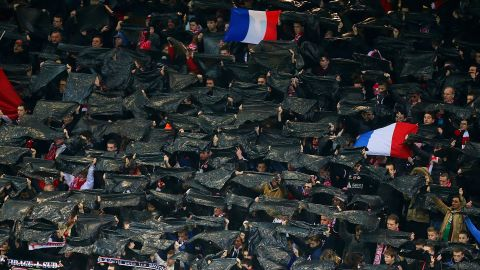 In Eastern France fans held aloft black flags in tribute to the victims at a match between Reims and Saint-Etienne at the Auguste Delaune stadium.