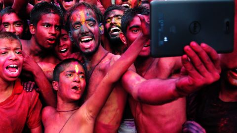 """People smeared with color take a photo Friday, March 6, during the Holi festival in Bangalore, India. <a href=""""http://www.cnn.com/2015/03/06/world/gallery/holi-2015/index.html"""" target=""""_blank"""">The Holi festival of colors</a> is a Hindu celebration marking the arrival of spring."""