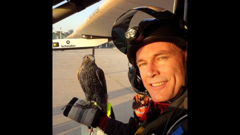 """Pilot Bertrand Piccard takes a selfie with a falcon Thursday, March 5, in Abu Dhabi, United Arab Emirates. Piccard and Andre Borschberg are attempting to become the first people <a href=""""http://www.cnn.com/2015/03/08/middleeast/solar-impulse-flight/"""" target=""""_blank"""">to fly around the world on a solar-powered plane.</a>"""