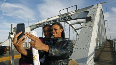 """Lazette Bowens, left, and her daughter Zoe take a selfie at the Edmund Pettus Bridge in Selma, Alabama, on Friday, March 6. Fifty years ago, state troopers <a href=""""http://www.cnn.com/2015/01/06/us/gallery/selma-bloody-sunday-1965/index.html"""" target=""""_blank"""">used brutal force and tear gas at the bridge</a> to push back hundreds of people marching to protest discriminatory practices. What the marchers did years ago """"will reverberate through the ages,"""" <a href=""""http://www.cnn.com/2015/03/07/us/selma-50-years-anniversary-live-events/index.html"""" target=""""_blank"""">President Obama said</a> on Saturday, March 7. """"Not because the change they won was preordained; not because their victory was complete; but because they proved that nonviolent change is possible; that love and hope can conquer hate."""""""
