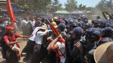Myanmar student protesters and nationalists clash with riot police during a march on March 10, 2015.