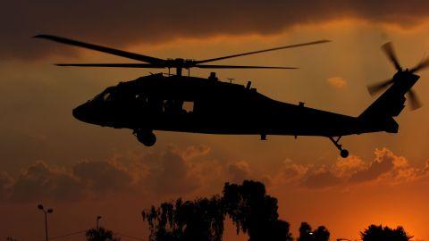A U.S. Army Black Hawk helicopter lands in Baghdad, Iraq, Feb. 13, 2008.