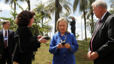 Clinton types on her phone during a visit to Brasilia, Brazil, in April 2012.