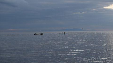 Fishermen go out to sea as night falls in Puerto Cortés, Honduras.