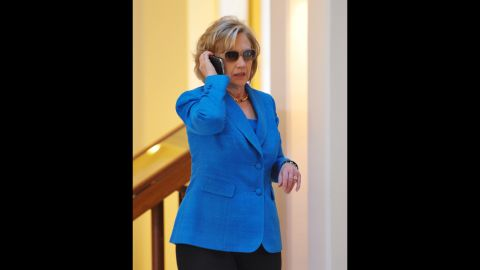 Clinton speaks on a phone in the lobby of a Honolulu hotel before briefing reporters on the Haiti earthquake in January 2010.