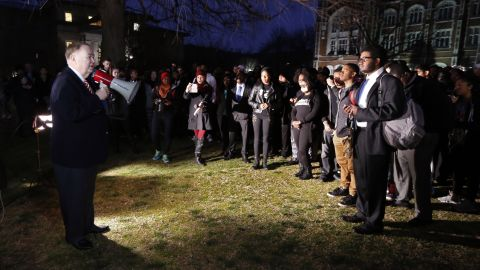 """Boren, with the bullhorn at left, speaks with students as they protest on March 9. """"I have a message for those who have misused their freedom of speech in this way,"""" he said. """"My message to them is: You're disgraceful. You have violated every principle that this university stands for."""""""