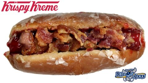 """Minor League Baseball's Wilmington, Delaware, Blue Rocks announced that its ballpark will begin offering a frankenfood concoction for the ages: A hot dog served inside a traditional Krispy Kreme glazed doughnut (raspberry jelly topping optional). The team is asking for fans' help <a href=""""http://www.milb.com/news/article.jsp?ymd=20150311&content_id=112186394&fext=.jsp&vkey=news_t426&sid=t426"""" target=""""_blank"""" target=""""_blank"""">naming the new doughnut dog</a>."""