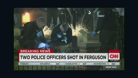 newday dnt sidner ferguson police officers shot_00001924.jpg
