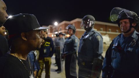 Protesters face off with Ferguson police officers on March 11.