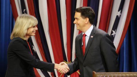 Walker shakes hands with Democrat challenger Mary Burke before facing off in a debate at the WMVS-TV studios October, 17, 2014, in Milwaukee, Wisconsin.