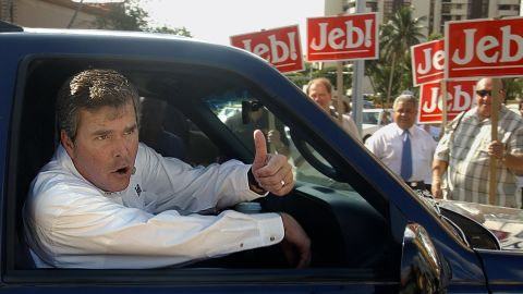 Bush gives a thumbs up signal from his car as he leaves a local polling station after casting his vote in Coral Gables, Florida, November 5, 2002.