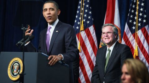President Barack Obama (left) speaks about Bush (center) while visiting Miami Central Senior High School on March 4, 2011 in Miami, Florida. The visit focused on education.