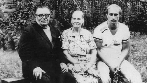 Putin poses with his parents, Vladimir and Maria, in 1985. A year earlier, he was selected to attend the Red Banner Institute of Intelligence, where he learned German and English.