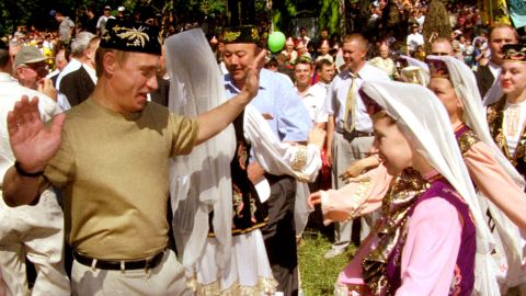 Putin dances with a young girl in Kazan, Russia, while taking part in midsummer festivities in June 2000.