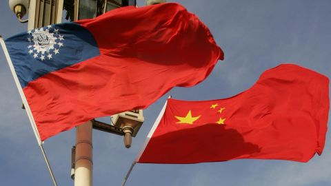 The flags of Myanmar (L) and China, which sent fighter jets to patrol over their shared border after the incident.