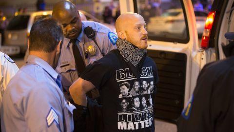St. Louis police arrest a demonstrator in St. Louis on March 14.