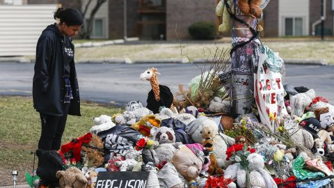 Suzanne Del Rosario pauses as she visits the memorial at the location of the shooting death of Michael Brown in Ferguson, Missouri, on March 15.
