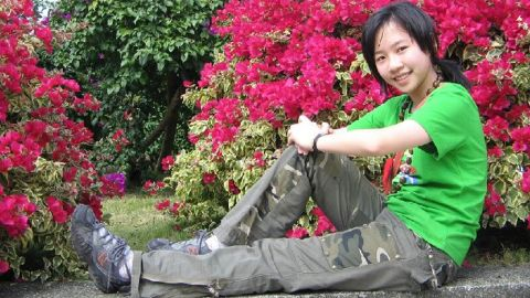 """Family photos show Tong dressed in a T-shirt and with short hair. <a href=""""http://www.cnn.com/2015/04/03/us/iowa-killing-chinese-student/"""">Her roomate said Tong embraced America </a>and shed T-shirts for clothes with frills. Her hair was long, almost down to her waist, with a dyed brown streak and curls. """""""
