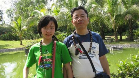 """Tong Shao with her father in China. The killing has devastated him: """"I can't stop thinking about this whole thing."""""""