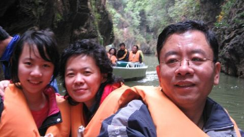 Tong Shao vacations with her mother and father in 2007. Her father says the trip remains his favorite memory.