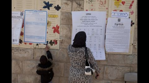 A woman and child stand outside a polling station in Abu Ghosh, Israel, on March 17.