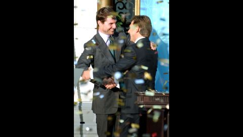 """Confetti rains down as actor Tom Cruise, left, embraces David Miscavige, the leader of the Church of Scientology, at the opening of a new church in Madrid in September 2004. Cruise is one of the world's most prominent Scientologists. """"What I believe in my own life is that it's a search for how I can do things better, whether it's being a better man or a better father or finding ways for myself to improve,""""  Cruise told Playboy magazine. """"Individuals have to decide what is true and real for them."""""""
