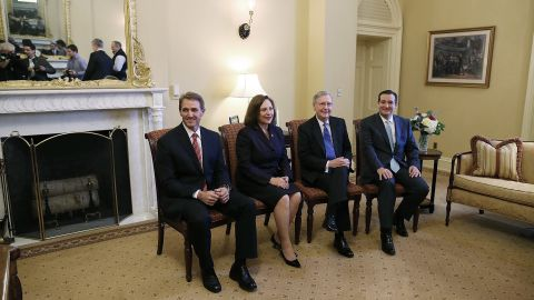 Then-Senate Minority Leader Mitch McConnell (second right), poses with Republican senators-elect Jeff Flake (left), Deb Fischer (second left), and Cruz (right) at the U.S. Capitol on November 13, 2012, in Washington, D.C.