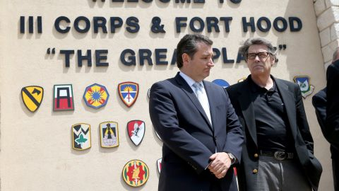 Cruz (left) and then-Texas Governor Rick Perry stand together during a press conference at the front gate of Fort Hood about Iraq war veteran, Ivan Lopez, who killed three and wounded 16 before taking his own life on April 4, 2014, in Fort Hood, Texas.