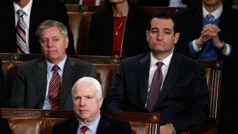 (Left to right) U.S. Sen. Lindsey Graham (R-SC), U.S. Sen. John McCain (R-AZ) and U.S. Sen. Ted Cruz (R-TX) listen as U.S. President Barack Obama delivers the State of the Union address to a joint session of Congress in the House Chamber at the U.S. Capitol on January 28, 2014 in Washington, D.C.