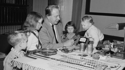 """Hubbard and his children in December 1959. They are testing a device called an E-meter, which Scientologists say measures the body's electric flow as an auditor asks a series of questions that they say reveals sources of trauma. <a href=""""http://religion.blogs.cnn.com/2012/07/03/tom-cruise-divorce-raises-question-what-is-scientology-anyway/"""" target=""""_blank"""">At the core of Scientology</a> is a belief that each human has a reactive mind that responds to life's traumas, clouding the analytic mind and keeping us from experiencing reality."""