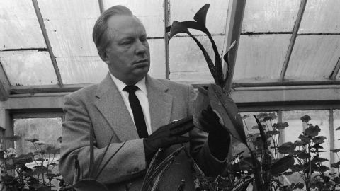 Hubbard works in his greenhouse in December 1959.