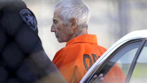 """Robert Durst, a wealthy New York real-estate heir, is escorted into Orleans Parish Prison after his arraignment in New Orleans on Tuesday, March 17. Durst faces felony firearm and drug charges in New Orleans, and he has been charged with first-degree murder in Los Angeles. Investigators say they believe Durst, 71, was behind the slaying of Susan Berman, Durst's longtime friend. Durst is also the focus of the HBO documentary series """"The Jinx,"""" which explores his wife's 1982 disappearance and investigators' suspicions that Berman was killed because she knew what happened to her. Durst has long maintained he didn't kill Berman or have anything to do with his wife's disappearance."""