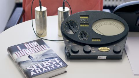 """An E-meter sits next to Hubbard's book """"Self Analysis"""" in Zurich, Swizerland, in January 2011."""