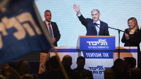 Israeli Prime Minister Benjamin Netanyahu greets supporters at the Likud party's election headquarters in Tel Aviv, Israel, on Wednesday, March 18. Netanyahu appears poised to keep his job after Likud grabbed at least 29 of the 120 seats in Israel's parliament, according to unofficial numbers. The Zionist Union came in second, with at least 24 seats.