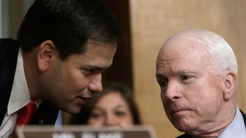 Sen. Marco Rubio (R-FL) (left) confers with Sen. John McCain (R-AZ) (right) as U.S. Ambassador to Syria Robert Ford testifies before the Senate Foreign Relations Committee October 31, 2013 in Washington, D.C.