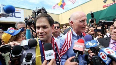 Rubio, left, and Florida Gov. Rick Scott speak to the media in Doral in February 2014.