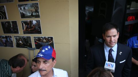 Rubio speaks to the media at the Doral restaurant in April 2014.