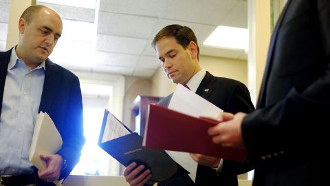 Rubio talks to aides in December before speaking on President Barack Obama's announcement about revising policies on U.S.-Cuba relations.
