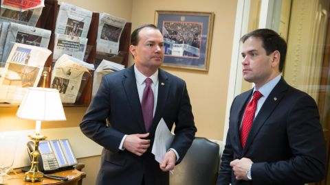Sen. Mike Lee, left, and Rubio talk before a news conference to introduce their proposal for an overhaul of the tax code in March.