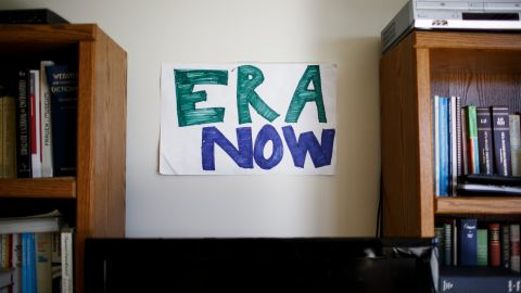 The offices of the Feminist Majority Foundation pay homage to an ongoing battle to secure equal rights for women. Amid framed posters gathered over the years are handmade signs like this one.