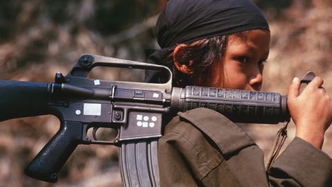 A 12-year-old soldier in Kamerplaw, southern Myanmar, at the headquarters of God's Army, in 2001. God's Army was a breakaway guerrilla faction of the Christian Karen National Union.