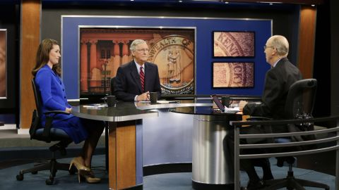 """McConnell and Kentucky Secretary of State Alison Lundergan Grimes, his Democratic opponent in the 2014 election, sit with """"Kentucky Tonight"""" host Bill Goodman before their debate in October in Lexington."""