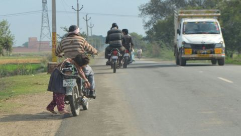 One father, desperate to get his daughter to sit her exams, lashed her to his motorbike to make sure she got to school.