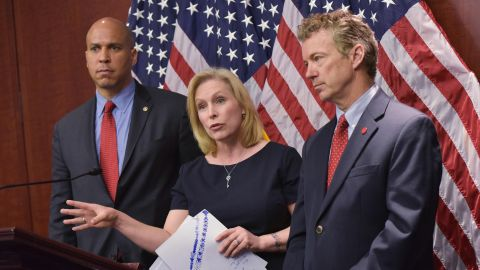 From left, U.S. Sens. Cory Booker, Kirsten Gillibrand and Paul attend a March 2014 news conference to announce a new medical marijuana bill at the U.S. Capitol in Washington.
