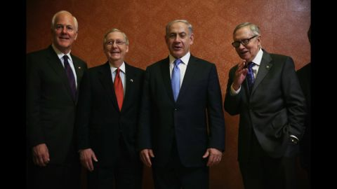 """Senate Majority Whip John Cornyn, left, McConnell, Israeli Prime Minister Benjamin Netanyahu, and Senate Minority Leader Sen. Harry Reid, D-Nevada, pose for photos at the U.S. Capitol in Washington on March 3, the day of <a href=""""http://www.cnn.com/2015/03/02/politics/netanyahu-speech-iran-obama-congress/"""">Netanyahu's controversial speaking engagement</a> before a joint session of Congress."""